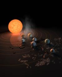 La ilustración muestra a la estrella TRAPPIST-1, una enana ultra-fría. El sistema tiene siete planetas del tamaño de la Tierra que orbitan. El concepto de este artista apareció en la portada de la revista Nature el 23 de febrero de 2017.